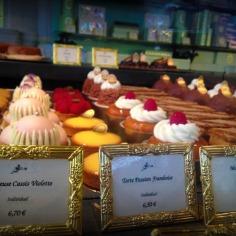 The Emblematic Religieuse à la rose : Cream puff pastry, rose petal custard cream, raspberries
