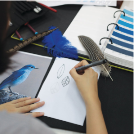 Creativity at work.. from a feather to a pendant (c)Nature